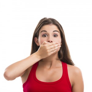 pretty girl covering mouth with hands