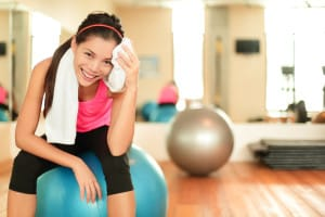 Woman Smiling at Gym Preventive Care