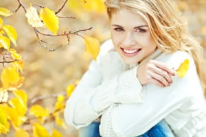 smilingblondeyellowleaves